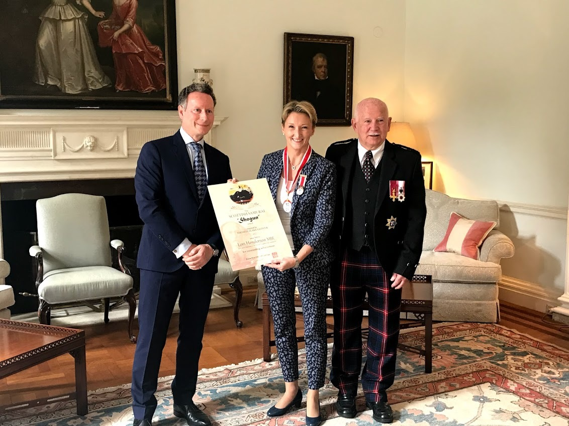 Lori Henderson with Lord Charles Bruce, left, and Ronnie Watt OBE, right.
