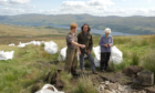 National Trust for Scotland president Neil Oliver inspects work at Ben Lawers.