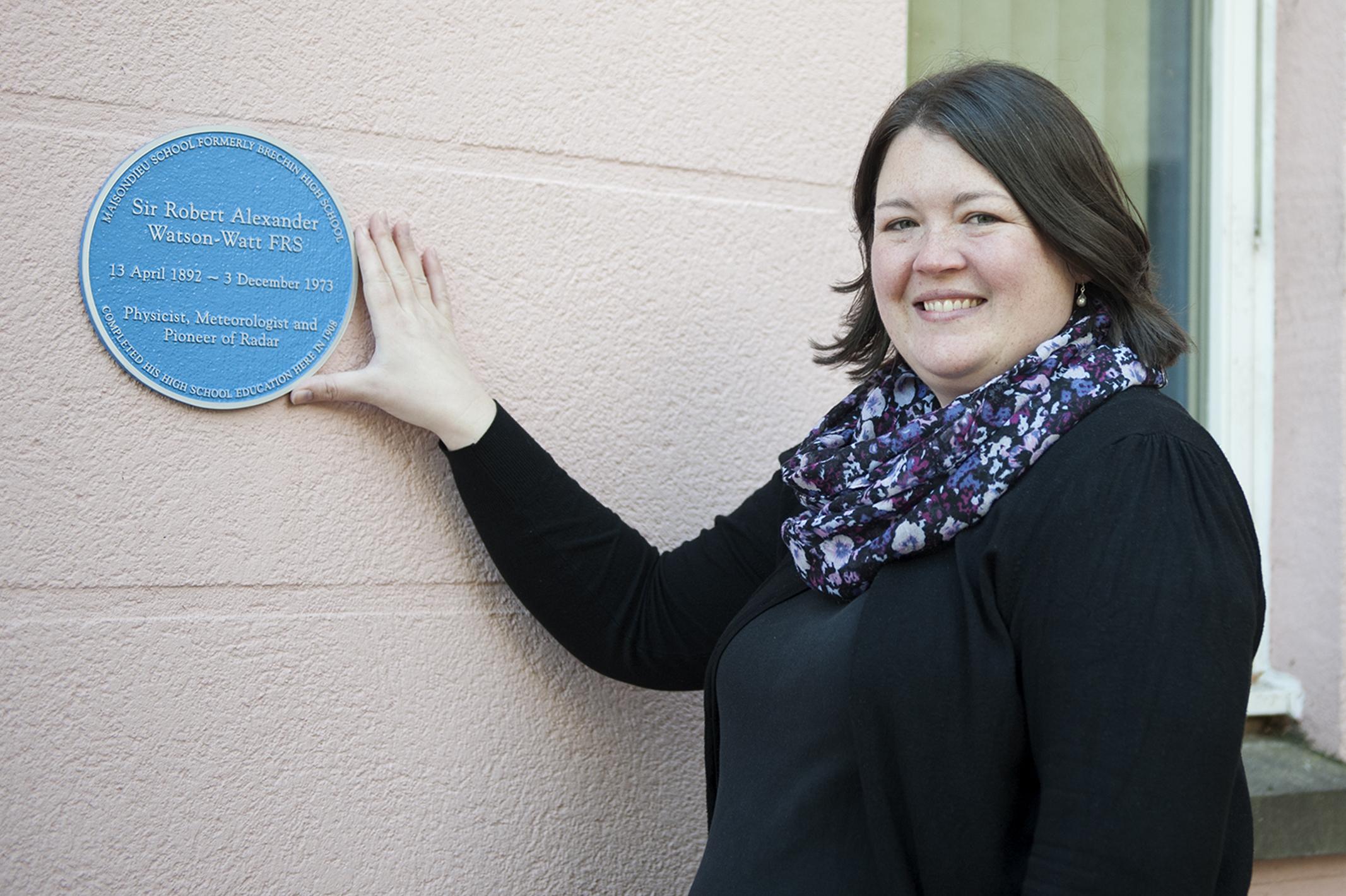 Deputy head teacher Sioehan Brown shows the plaque unveiled in memory of Robert Watson Watt.