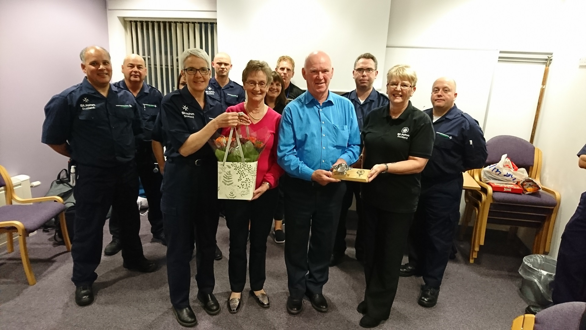 Bill and his wife and presented with gifts by the team.