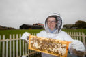 Charley Clark has worked at the distillery for over a year and has become passionate about bees.