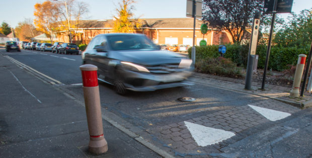The bollard has been disabled and now allows traffic from both directions.