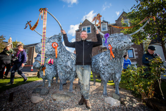 Blacksmith Kev Paxton with the Crieff coos.