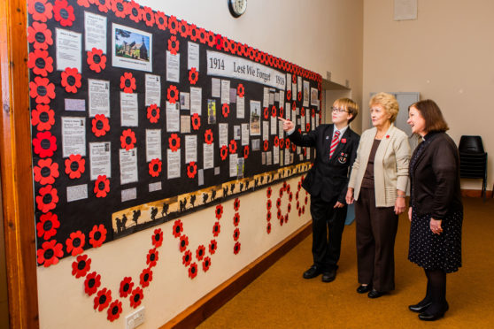 Cameron Stuart, Mrs Linda Nicoll and the Rev Annette Gordon with the display.