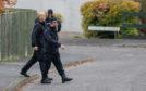 Police go door-to-door in Highland Road, Crieff, near where Martyn Cruickshank was last seen.
