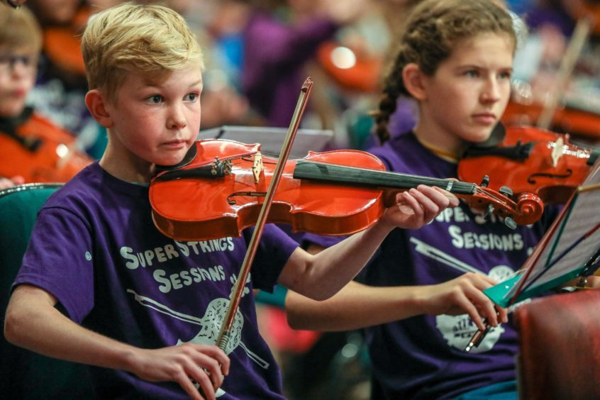 Youngsters from the Super String Orchestra performing in Dundee.