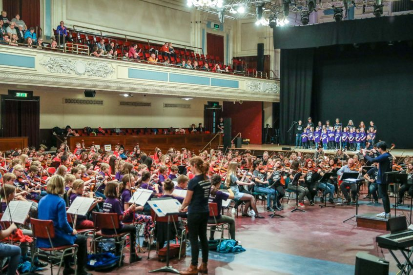 The musicians gathered in the Caird Hall.