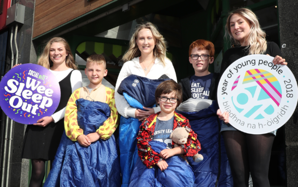 Alice Thompson, co-founder of Social Bite and organiser of the Wee Sleep Out, with fellow staff and a group of kids who are getting on board the project.