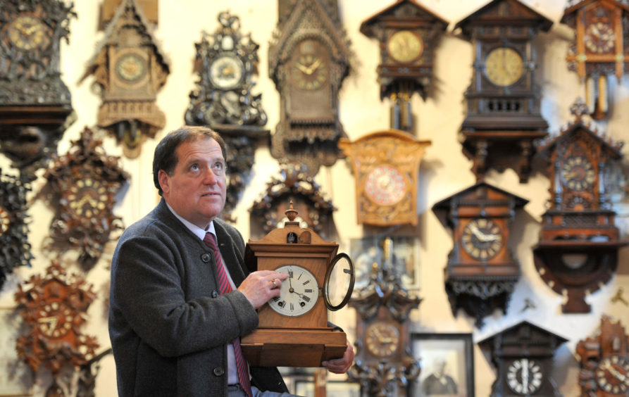Roman Pierkarski starts changing the cuckoo clocks in his museum