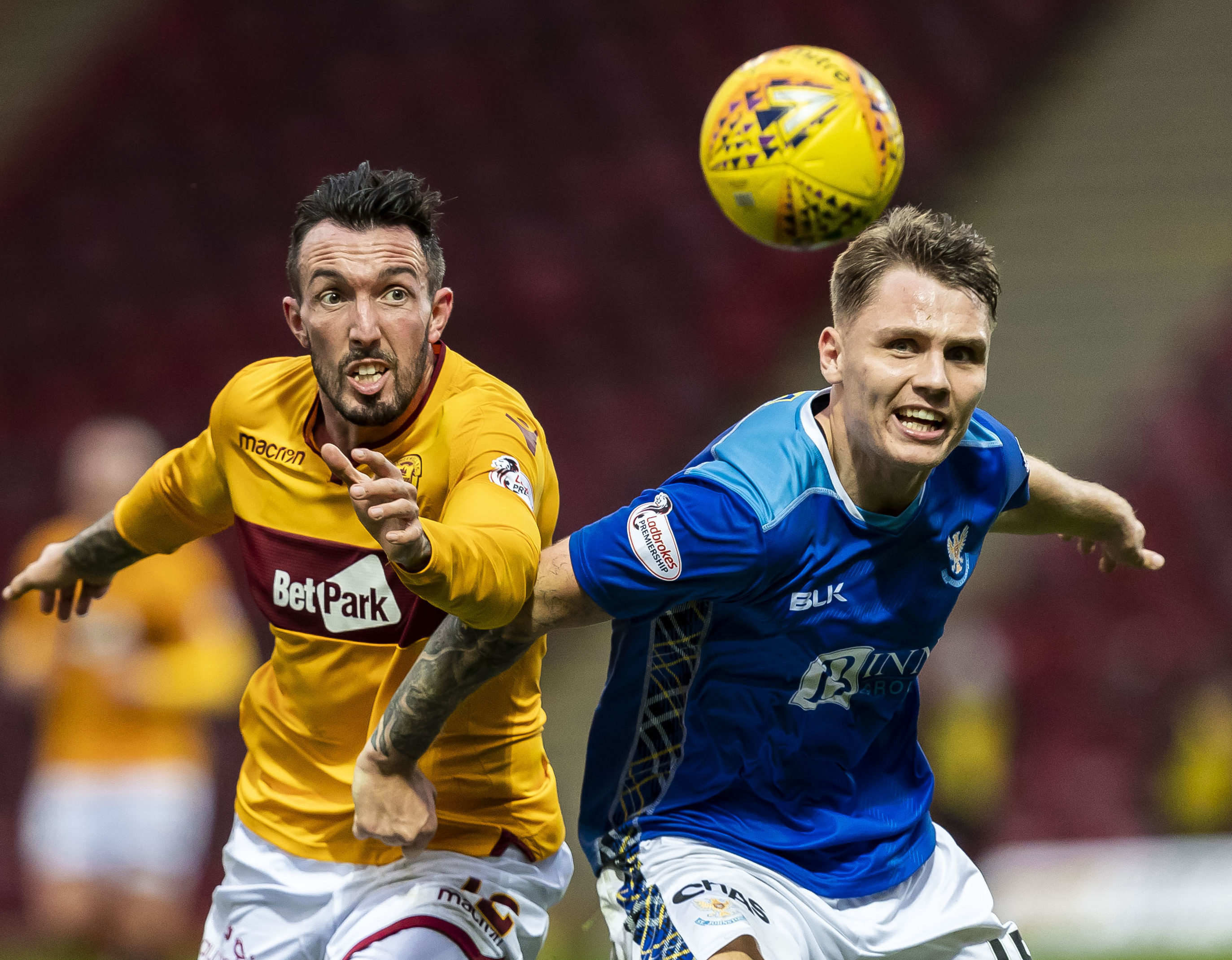 Jason Kerr battles with Motherwell's Ryan Bowman.
