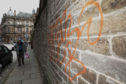 The outer wall of the medieval Howff on Barrack Street was damaged by yobs in October