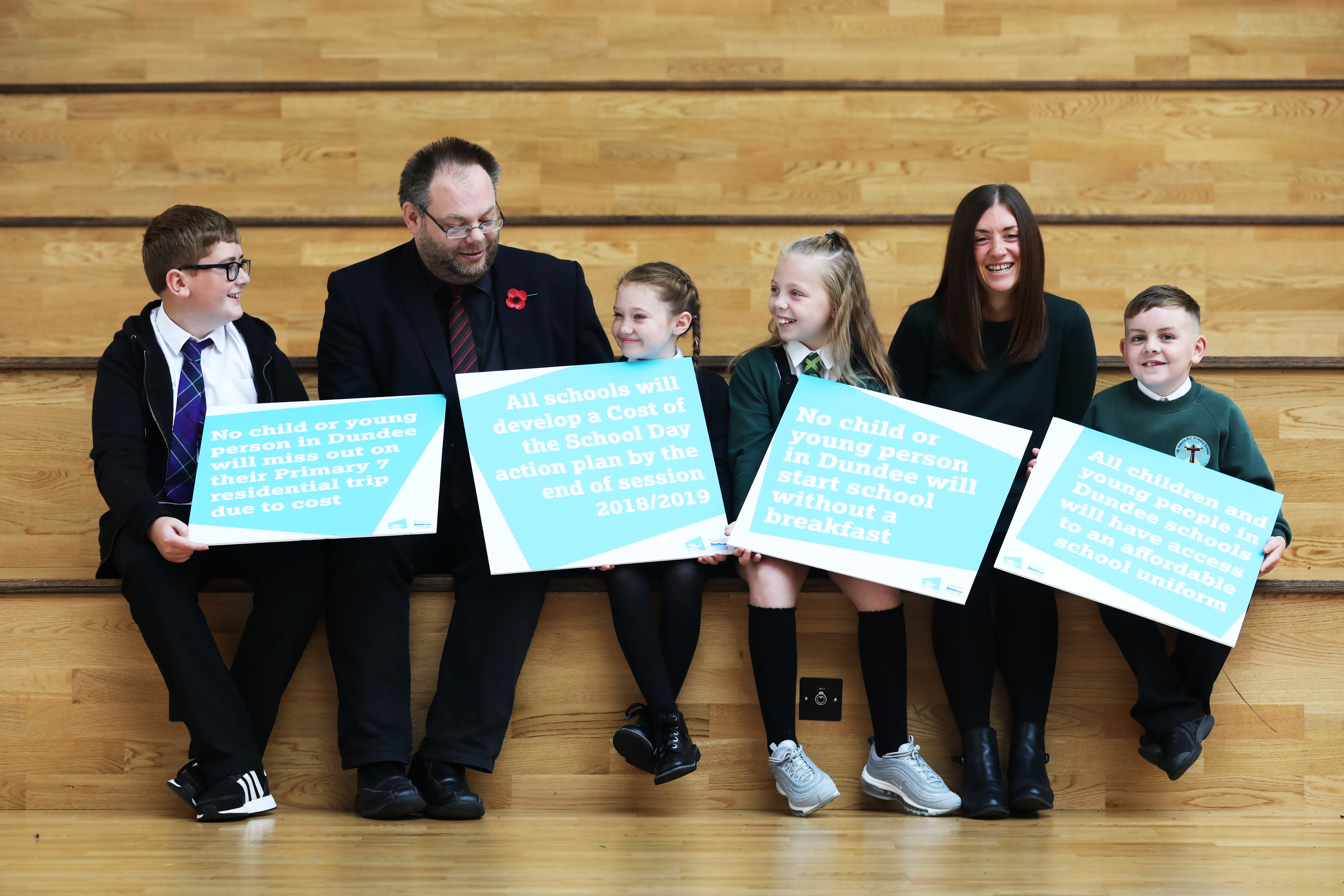 Councillor Stewart Hunter and Child Poverty Action Group Scotland project co-ordinator Susan Epsworth with pupils from Longhaugh and St Francis primary schools.