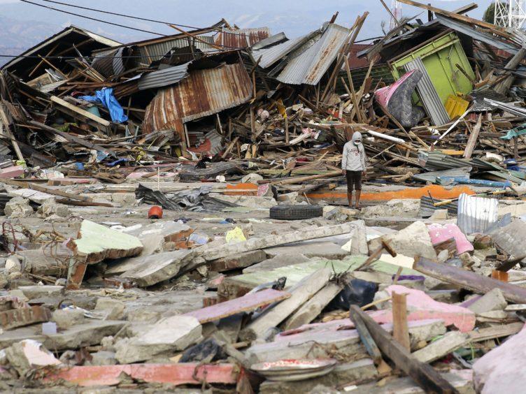 Toppled homes in Palu (AP Photo/Aaron Favila)