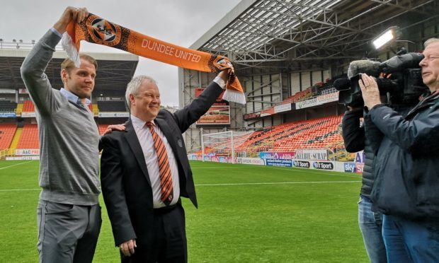 Dundee United chairman Mike Martin parades new manager Robbie Neilson in front of the media at Tannadice Park.