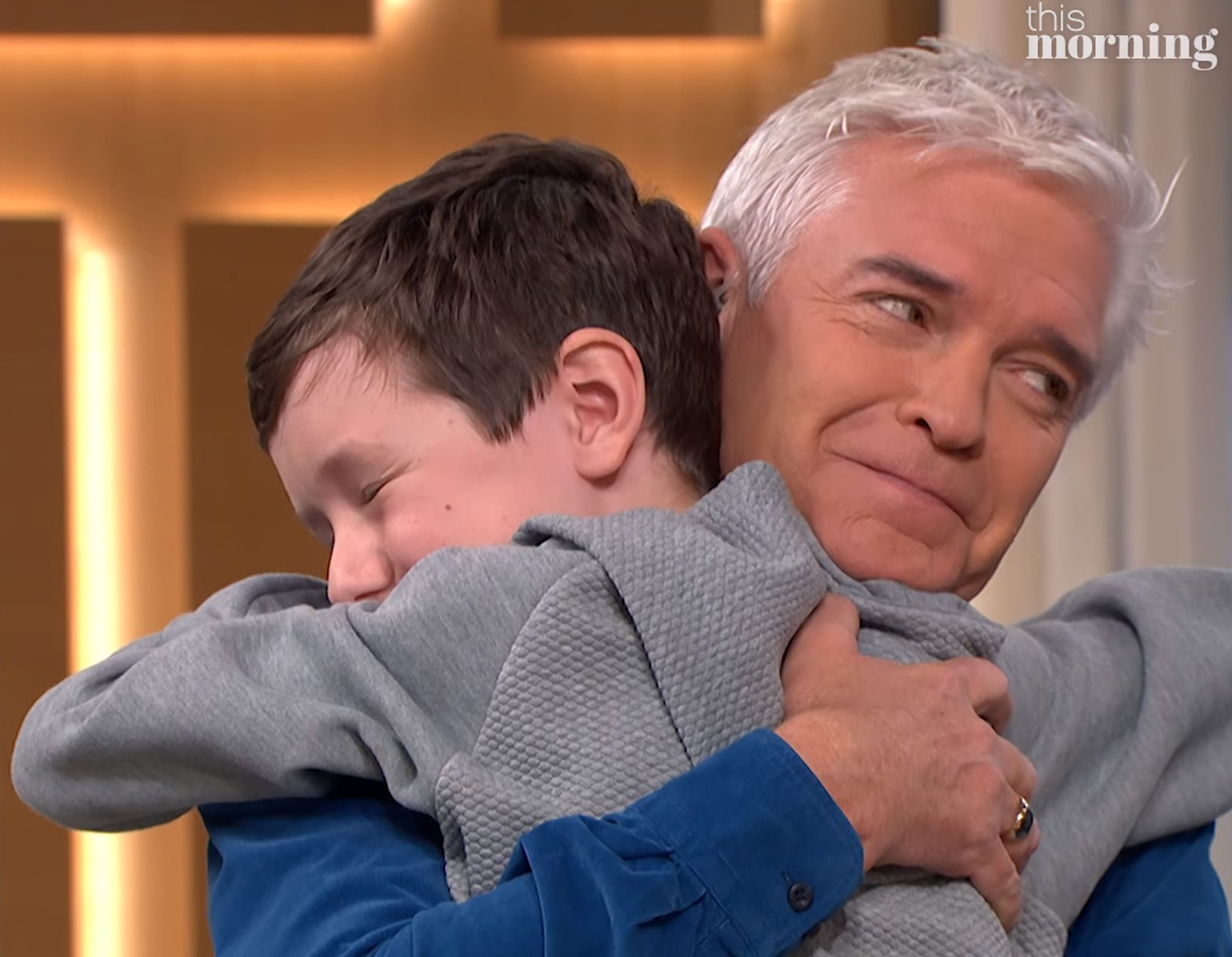 Micjael Glaister hugging Philip Schofoeld on This Morning.