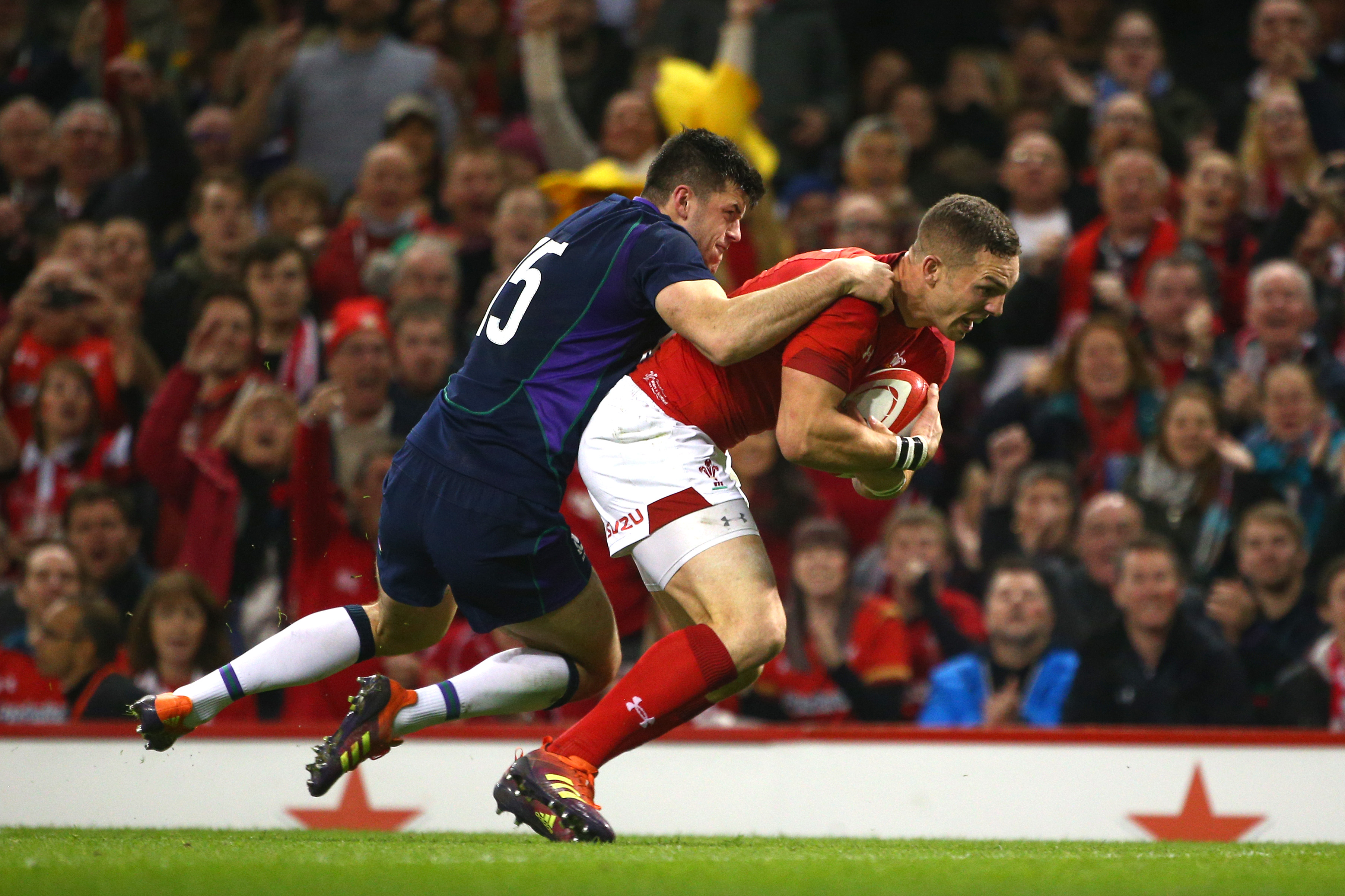 George North goes through for his side's first try despite Blair Kinghorn's tackle.