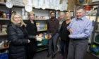 Rizwan Rafik welcomes politicians at a recent event at the TBM foodbank