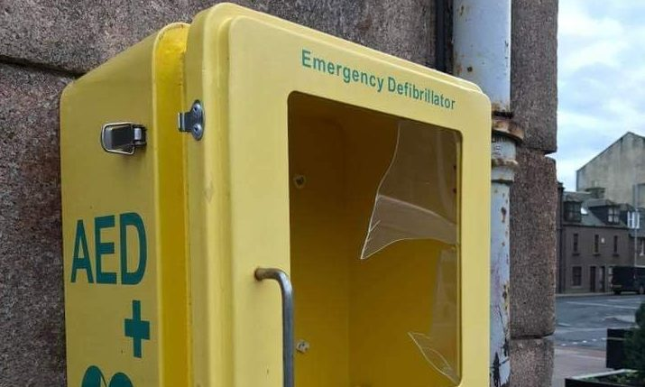 The damaged defibrillator cabinet