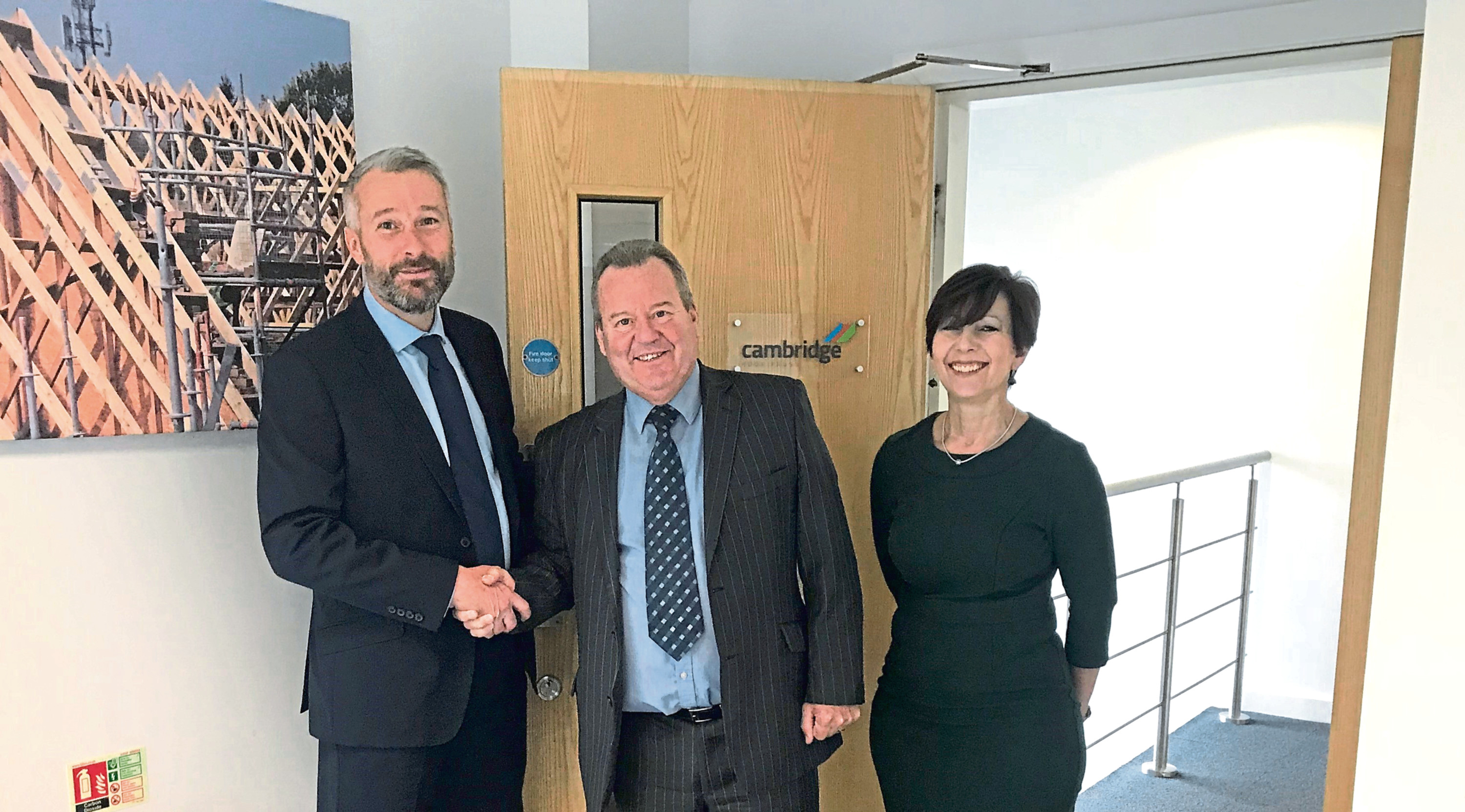 Donaldson Timber Engineering managing director Jonathan Fellingham with Cambridge Roof Truss managing director Jack McMinn and director Sue Mills.