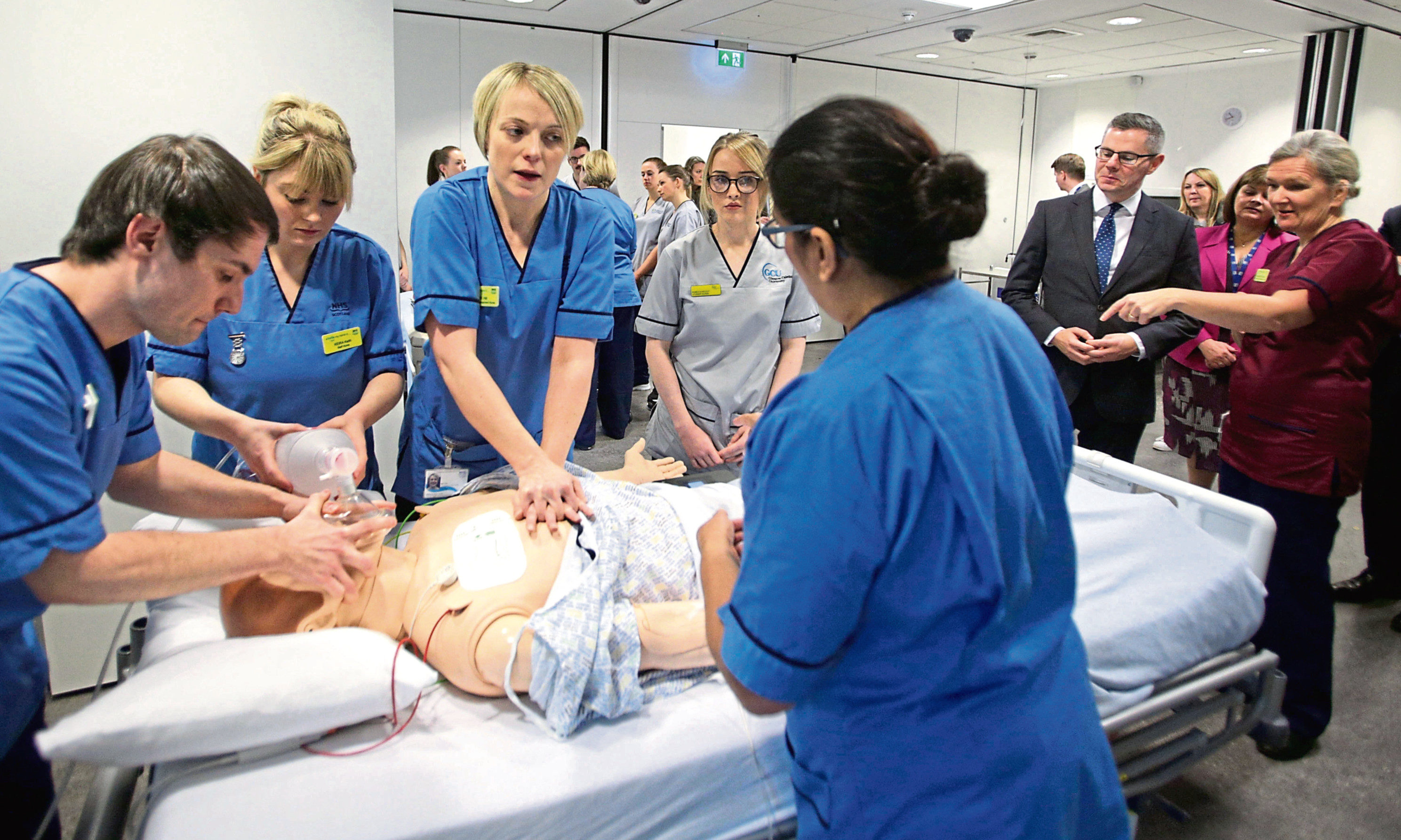 Scottish Finance Secretary Derek Mackay (second right) watches a teaching session on cardio-pulmonary resuscitation (CPR) in a simulated ward environment at the teaching and Learning Centre, Queen Elizabeth University Hospital, Glasgow.