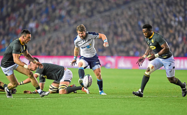 Scotland's Peter Horne hacks the ball on with Jesse Kriel and Siya Kolisi of South Africa looking on during the Autumn International match at BT Murrayfield, Edinburgh. PRESS ASSOCIATION Photo. Picture date: Saturday November 17, 2018. See PA story RUGBYU Scotland. Photo credit should read: Ian Rutherford/PA Wire. RESTRICTIONS: Editorial use only, No commercial use without prior permission