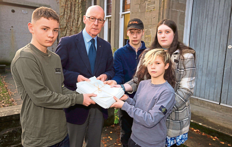 John Swinney receives a petition from pupils Sol Archibald, Duncan Fairlie Tori Rennie and Ben Gilyeat.