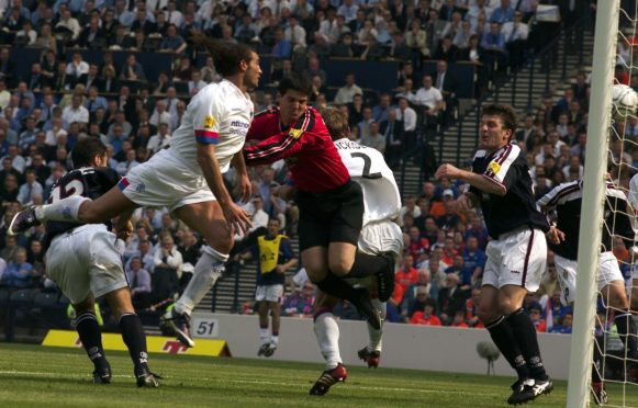 Lorenzo Amoruso (left) rises above the Dundee defence to head the winning goal of the match in 2003.