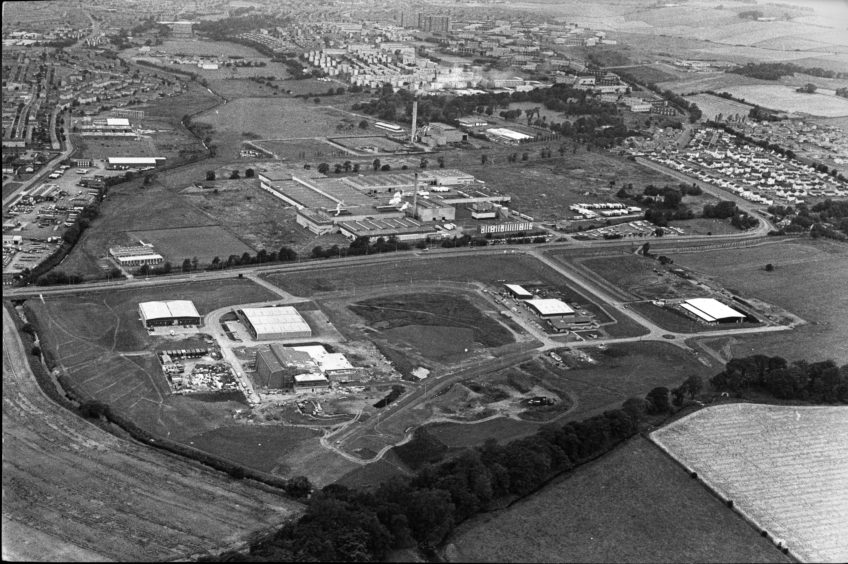 Pitkerro Industrial estate looking towards the Michelin Factory and Baldovie Incinerator with the Whitfield housing scheme in the background.