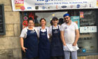 Wendy Frame (second from left) and her kitchen staff will serve a fat-free St Andrew's Day treat