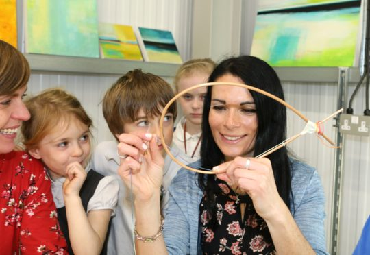 Gayle makes a dreamcatcher at an Explore Play Create workshop run by Victoria Wylie and Rachel Bower.