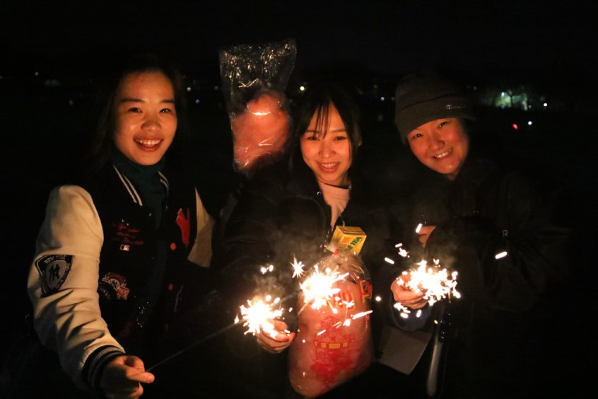 A group enjoying the fireworks display at Baxter Park, Dundee.