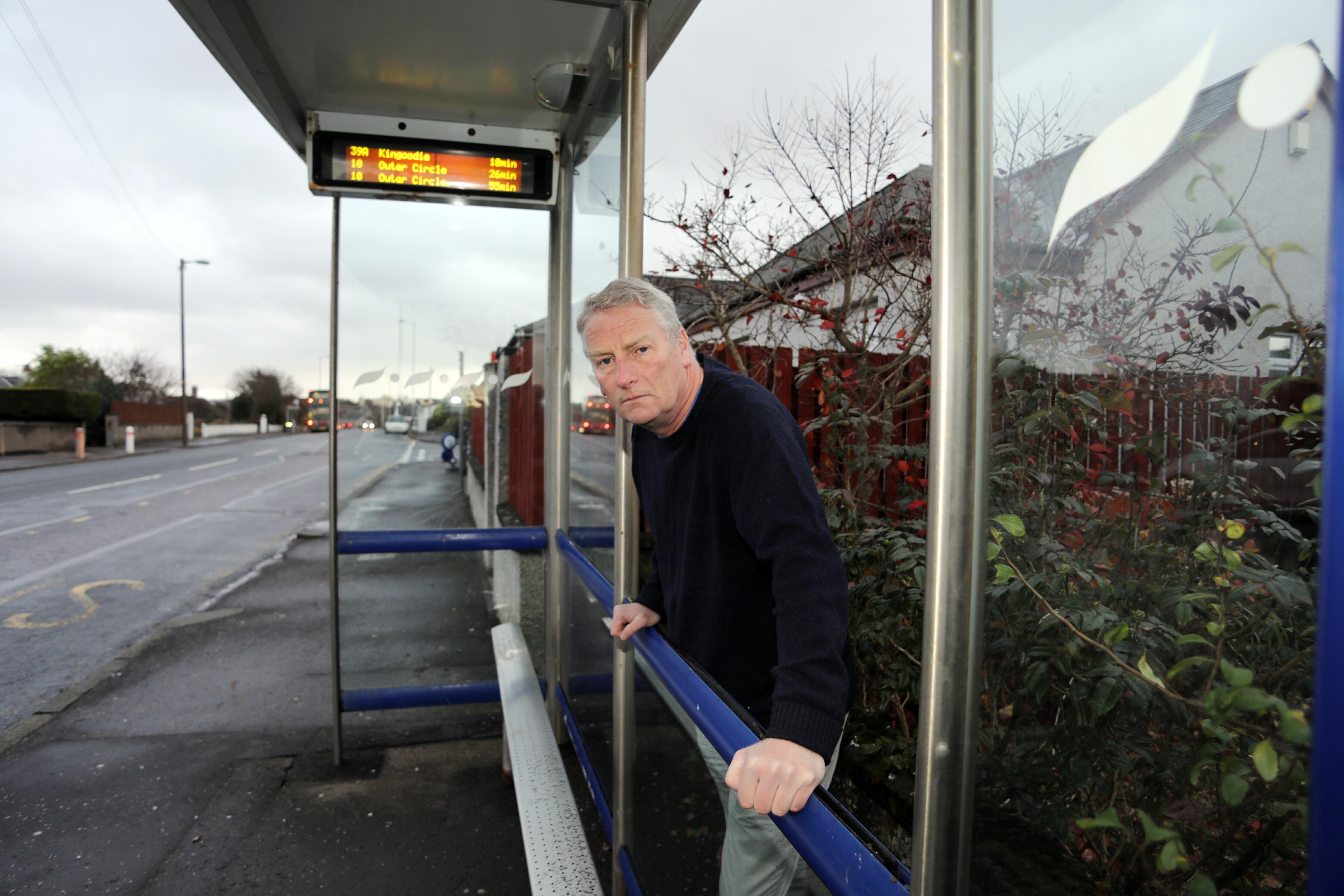 Councillor Craig Duncan at the bus shelter.