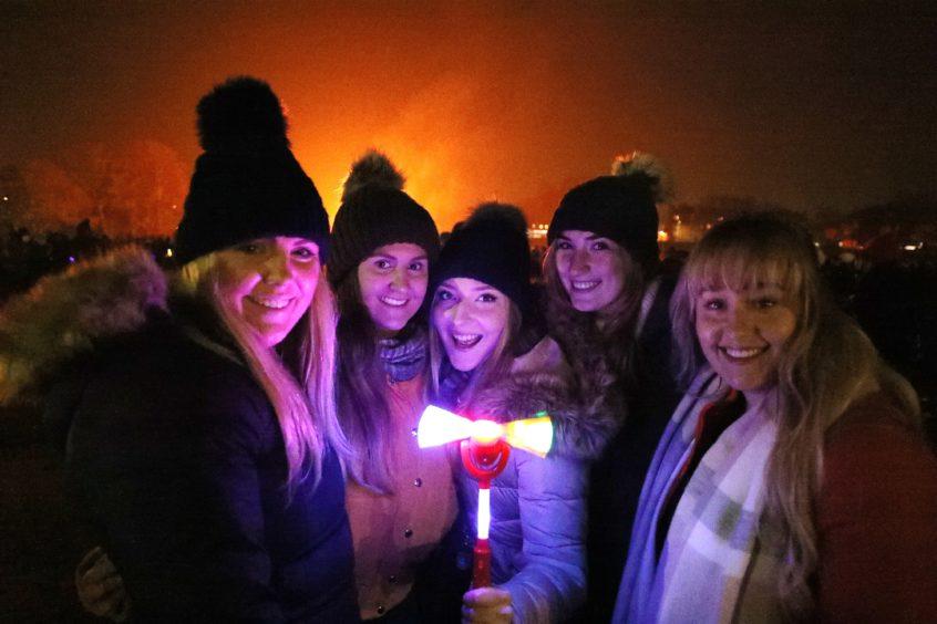 A group of friends enjoy the fireworks at Baxter Park.