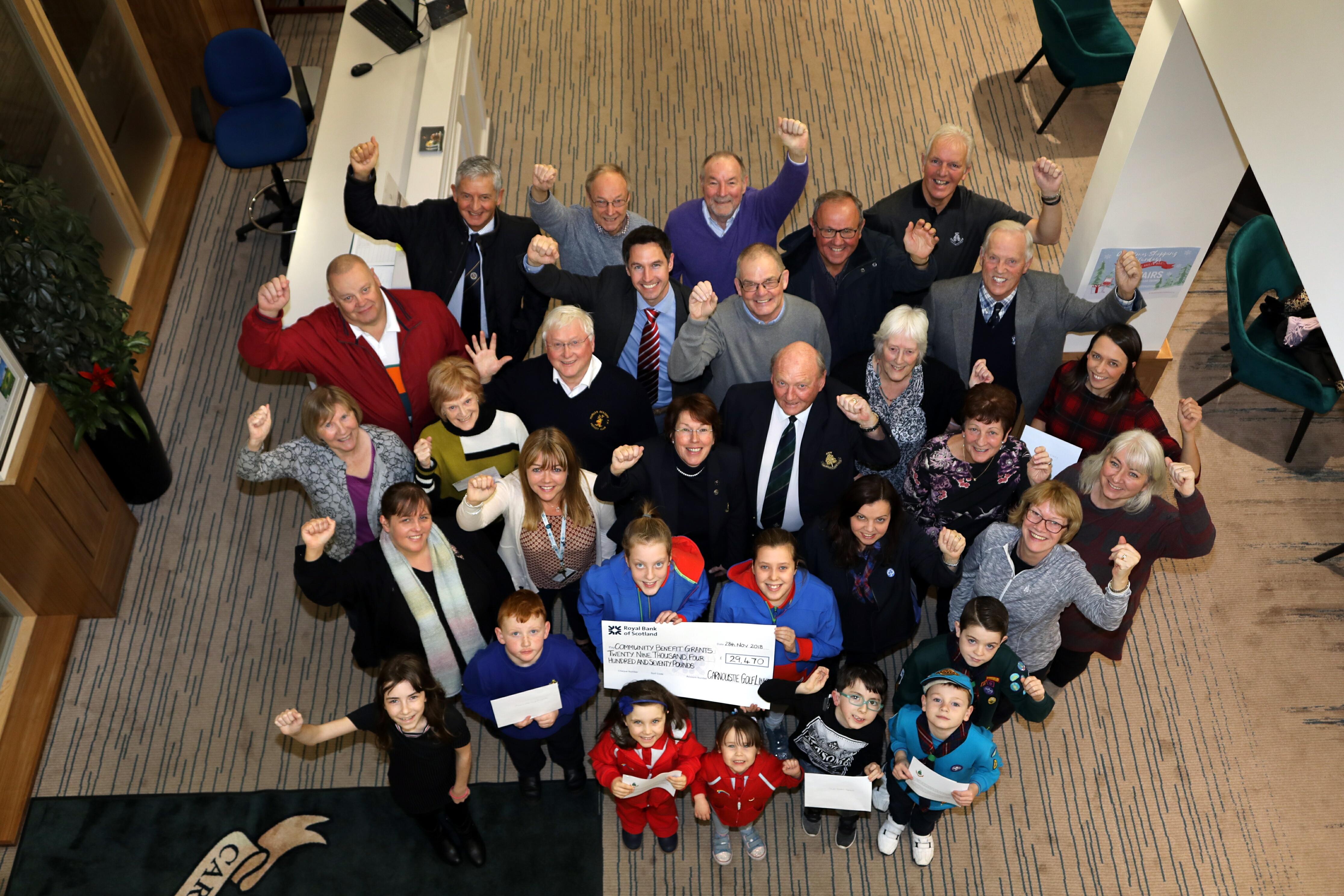 Recipient representatives and CGLMC figures at the Links House handover