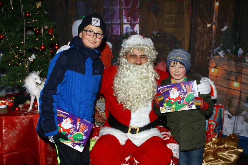 The Monifieth xmas lights switch on over the weekend.  Santa with Josh (6) & Matthew Milne (10)
