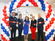 Celebrations as Tesco's Dundee customer engagement centre   following completion of a multi-million pound revamp. Picture shows Public Finance Minister Kate Forbes MSP cutting the ribbon.