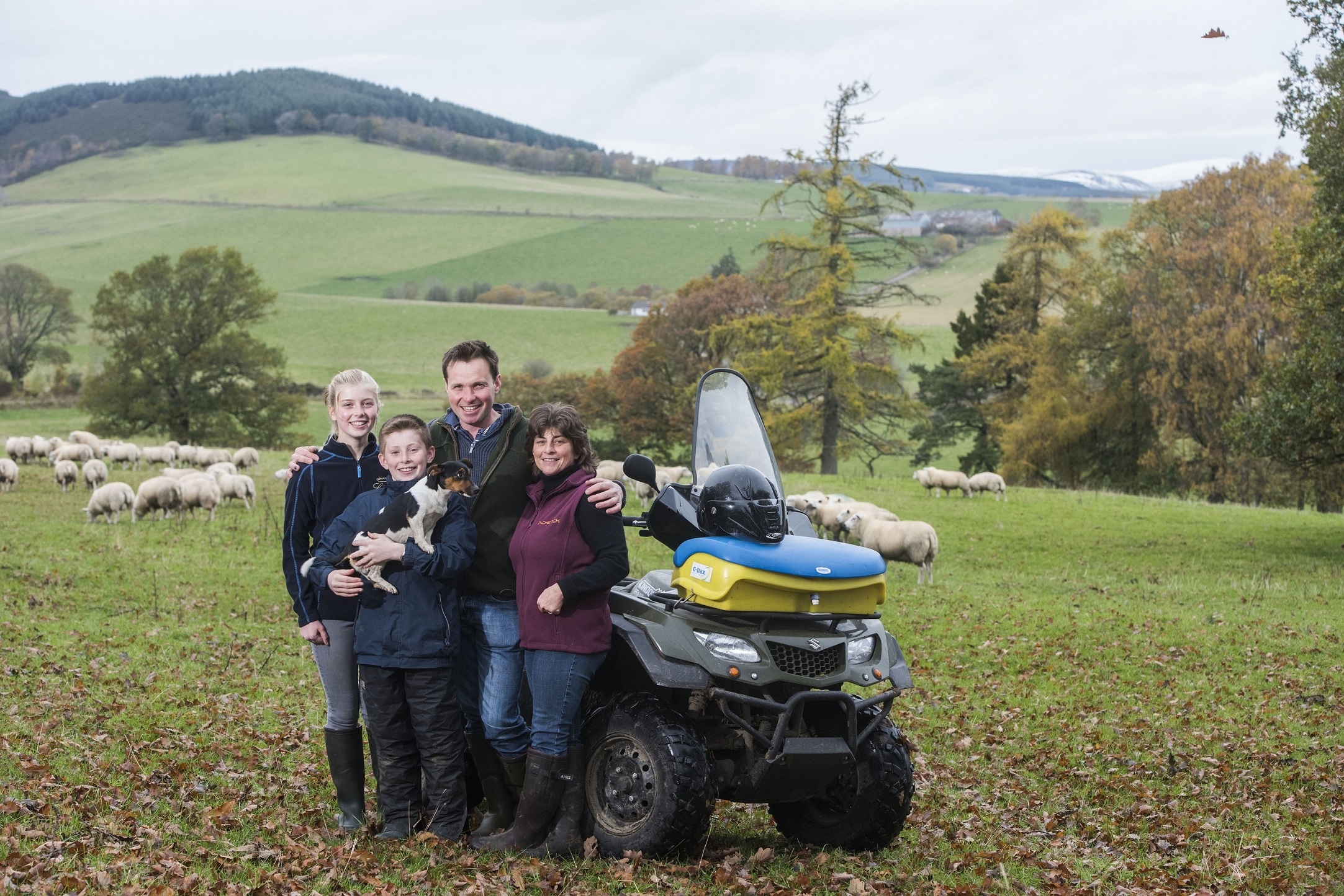 Neil and Debbie McGowan on their farm, Incheoch, with children Tally and Angus and dog Skye.