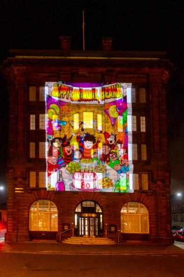 The DC Thomson building lit with characters from The Beano, Albert Square, Dundee.