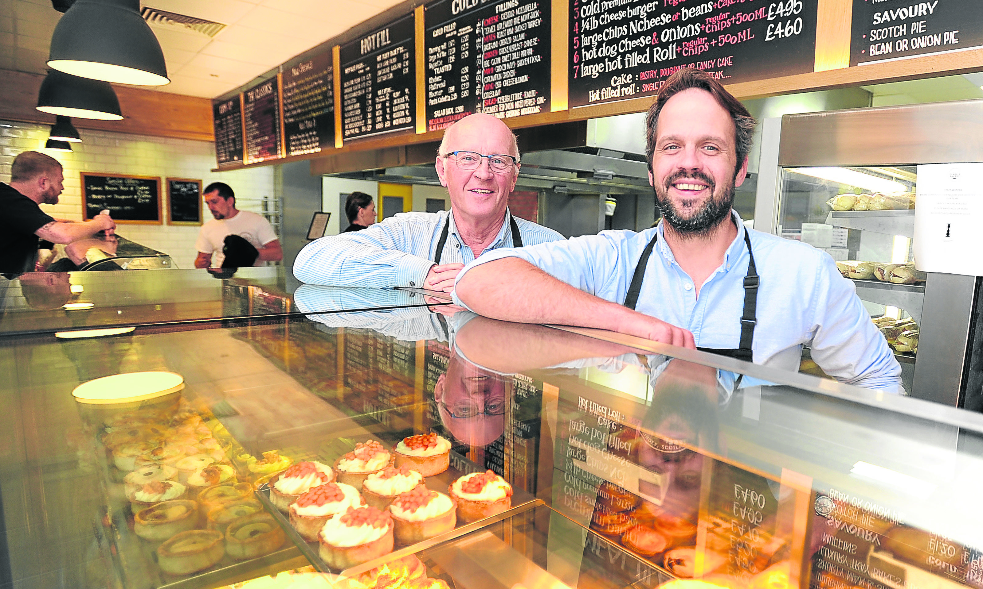 Owner Jonathon Clark (right) with father Alan Clark in the bakery shop on Annfield Street.
