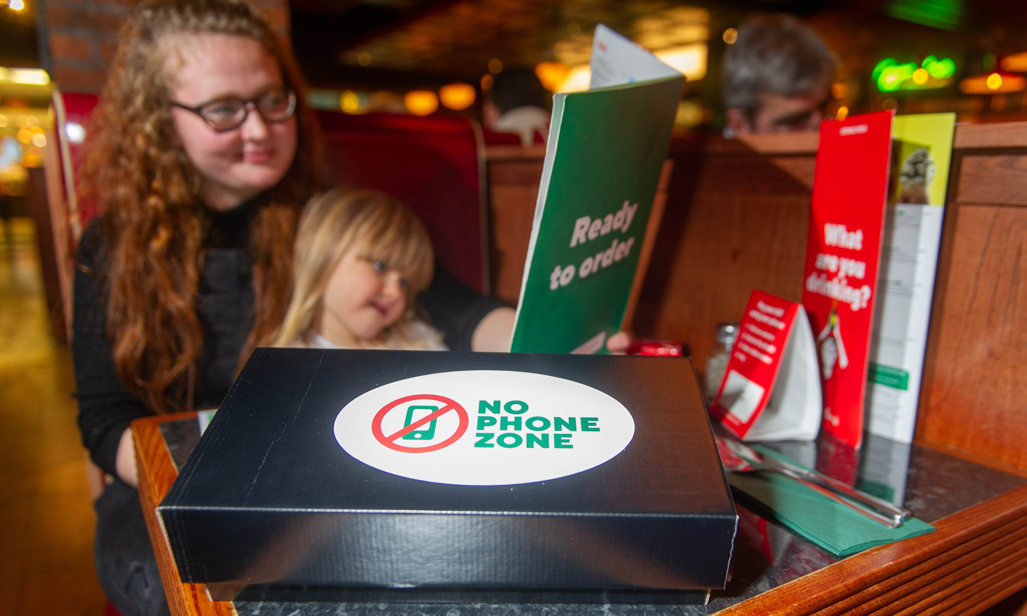 Mum Ashleigh Fergus and daughter Rosie McPherson enjoy a phone free dinner in the Overgate Frankie and Benny's.