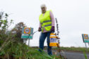 Villager Marilyn Mauran has previously taken matters into her own hands and cut back vegetation covering speed limit signs