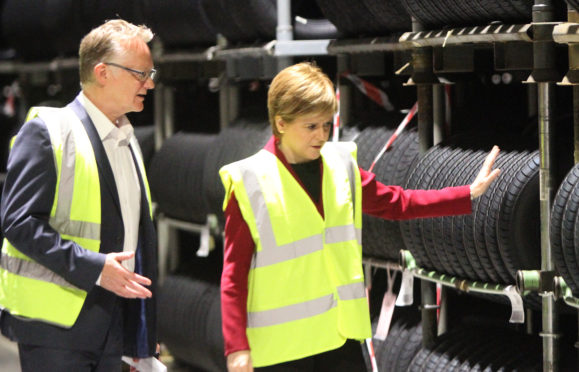 John Reid, Michelin Dundee manager, and Nicola Sturgeon at the factory in June 2017.