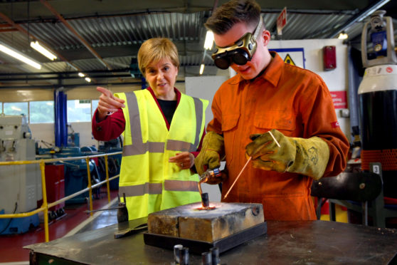 First Minister Nicola Sturgeon on a previous visit to the Michelin plant in Dundee.