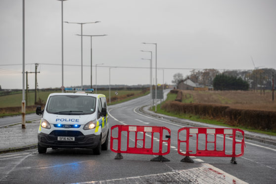 The road was closed for several hours after the crash.