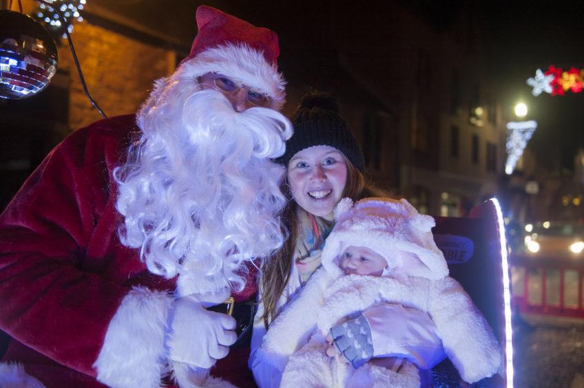 l to r; Santa; Kiana Brady and Talia at the Kirriemuir Christmas light switch on.