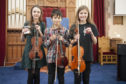 Caption (description) -  CR0004434, The  Angus Strathspey & Reel Society's,  51st  Traditional Fiddle Festival, Picture shows, l to r, Group 1 winner Charlotte Slater from Ellon, Murray Todd from Shetlands and Holly Stephen from the Shetlands, 10 November 2018
