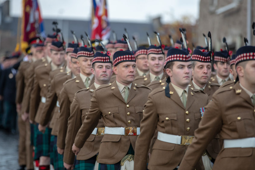 Members of 7 SCOTS march through the streets of Perth to mark Armistice Day.