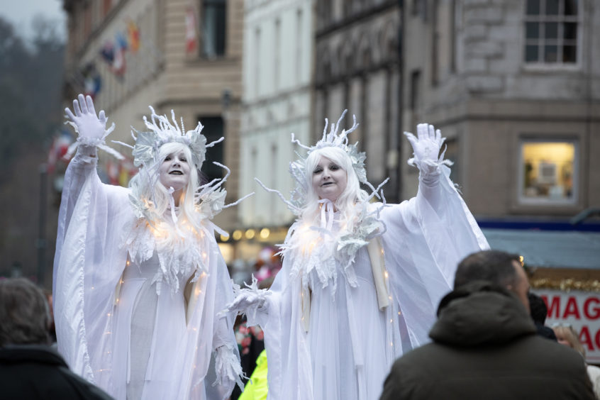 Ice Queens mingle with the crowds.