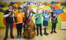 Benny Higgins with children from the Big Noise Govanhill orchestra.