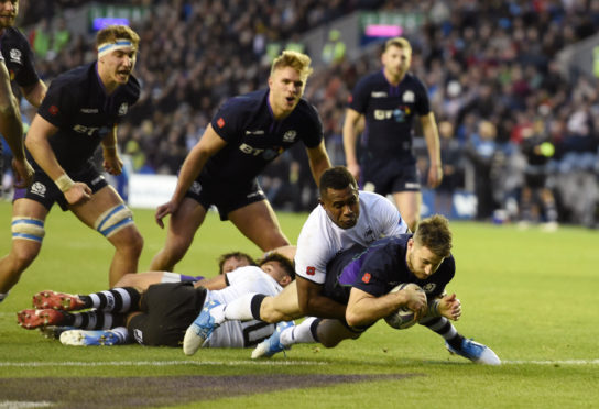 Tommy Seymour scores his second of his hat-trick in Scotland's 54-17 romp over Fiji.